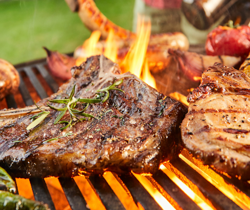 Close up of steak, corn, chicken and green peppers on the grill for trend article about Summer 2021 BBQ flavor trends